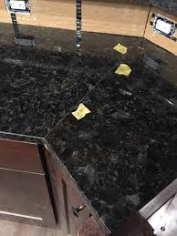 the pictures are of the seams is this typical for dark colored granite has anyone had this color granite installed before and can show me what their seems