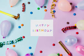 Happy Birthday Message On Blue And Pink Surrounded With