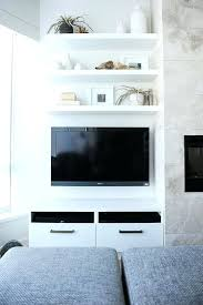 white floating shelves around tv three floating shelves over wall mount best floating tv stands
