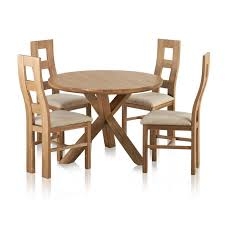 trinity natural solid oak round table with 4 wave back and plain beige fabric dining