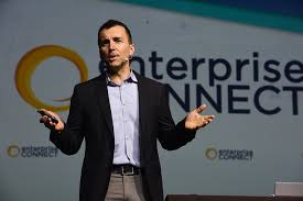 microsoft s zig serafin addresses the crowd during his enterprise connect keynote