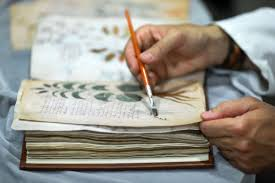 a facsimile of the voynich mcript undergoing quality control in spain in 2018 photo by cesar manso afp getty images