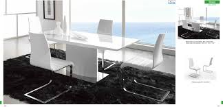 dining room rectangle white wooden table with single leg bined with white chairs with silver