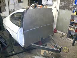 club cars once the remedial work was completed the trailer was rubbed down and painted in primer the wiring was made using the cars original rear wiring loom so all