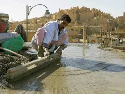 concrete roofs aren t necessarily a costly investment here an egyptian worker levels