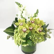 hydrangeas orchids and green contrasts