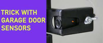 how to trick garage door sensors