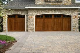 wooden doors garage doors with stone border
