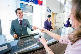 delta airport customer service agents greet customers at detroit metropolitan airport