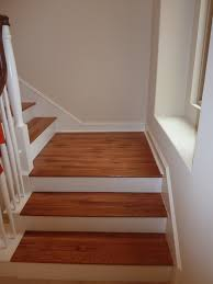 brown color vinyl wood plank flooring on stairs with wall and wood railings painted with white color ideas