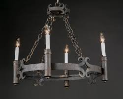 italian round wrought iron chandelier suspended by four iron link chains