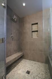 spa bathroom showers: the neutral porcelain tiles in this spa like shower create smooth walls and seating the pebble flooring is a beautiful touch thats pleasing to the feet