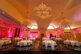 crystal chandelier reception hall and cathedral ceiling with love the pink lights 900x598px