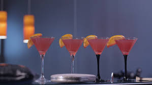 lighting for a bar. four cosmopolitan cocktails on a bar hd stock video clip lighting for