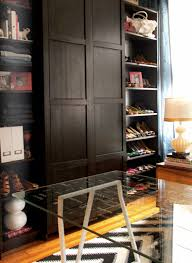 stunning master bedroom converted to walk in closet office with ikea billy bookcases housing rows and rows of shoes flanking ikea pax wardrobe with 2 doors