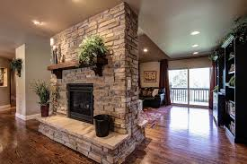 double sided gas fireplace family room traditional with capstone home renovations double image by capstone home renovations
