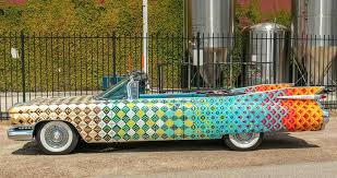 this saint arnold brewing pany art car painted by robynn sanders hale is the