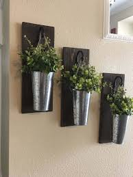 hanging wall racks with tall metal pails