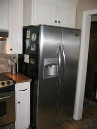 cabinets over refrigerator. gc built out the cabinet over refrigerator so i can actualy use it cabinets