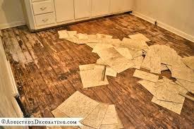 how to remove vinyl flooring glue from concrete floor boards underneath vinyl tile possible asbestos tile