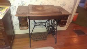 antique sewing machine from the singer manufacturing company in 5 drawer cabinet filled with old ons notions threads etc