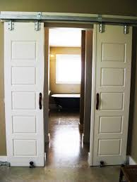 agreeable white polished wooden sliding interior barn doors for bedroom door ideas with 5 panels door