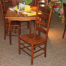 36 x 48 colonists brown maple dining table with 2 12 inch leaves and 4 side chairs