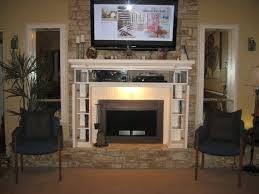 tv above fireplace mantel with storage home