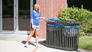 unk student brandy herley of spalding uses one of the 52 new outdoor recycling containers on