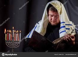 Prayer For Lighting The Menorah Candles Jewish Man With Beard Lighting The Candles Of A Menorah