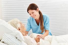 Geriatric Nursing Caring Geriatric Nurse Cares For Ill Senior Citizen In Nursing