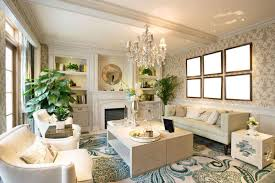 small luxurious living room that features crystal chandelier and off white home accents