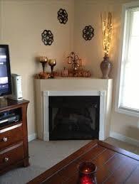Corner fireplace mantle fall decor. Miss my fireplace!