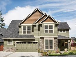 Eplans house plan ideal for a corner lot the combination of wood siding and stone complements a carriage style garage door and cedar shingle detailing on
