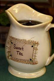 On the tea pitcher use a touch of hot glue, some burlap, craft paper