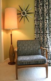 mid century lighting. funky long necked floor lamp rocks midcentury setting mid century lighting