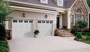 clopay garage doors prices. Multi Colored Brick Home With Two White Steel Clopay Garage Doors Windows On The Top Prices R