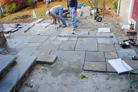 stone patio installation: further bluestone installation of upper patio