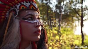 portrait of attractive indian woman in native american indian headdress with bright makeup autumn forest stock fooe and royalty free videos on