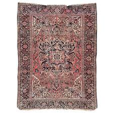 pink persian heriz rug with medallion and blue yellow detail for