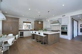 kitchen backsplash white cabinets brown countertop. White And Brown Kitchen With Distressed Island Backsplash Cabinets Countertop A