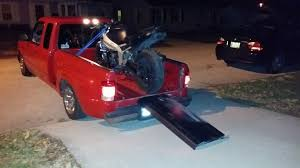 Anyone else use their tailgate as a motorcycle ramp? : fordranger