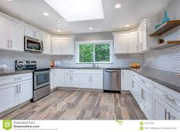 Open Concept Kitchen Equipped With Stainless Steel Appliances Stock