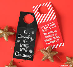 Free printable Christmas wine tags. Hostess gifts (or presents for your wine -loving