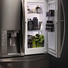 lg black french door refrigerator. rustic yet refined accents make our art metro themed lg limitless design kitchen more modern. lg black french door refrigerator