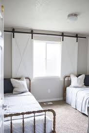 this barn door window treatment plays off the cur barn door trend in home decor kristen whitby of ella claire inspired came up with this cute idea for