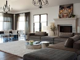 large contemporary open concept family room with white walls dark hardwood floors a standard
