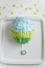 balloon pinata favor via ruffled paper mache balloons make a good craft for kids to make this individual party pinata for each guest to pull on no