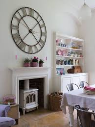 example of a cottage chic dining room design in london with white walls and