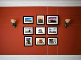 display framed photographs on a wall